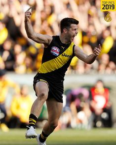 Trent Cotchin 2019 GF celebrates after kicking a goal in the dying minutes of the game. It was a we won the premiership celebration. Richmond Football Club, Tigers, Celebration, Kicks, Goals, Running, Yellow, Sports, Black