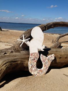 Starfish wishes and mermaid kisses...  This birch wood mermaid is a beauty with her tail covered in crushed shells all handmade, collected broken pieces found and crushed by me. She holds a white finger starfish She measures 15 long x 8 at widest point across