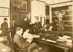 """""""Office, Slade & Boyer, 1910.  Two tickers in front of the windows received securities and commodities prices.  Prices of securities, including AT's, are posted on the board right rear."""""""