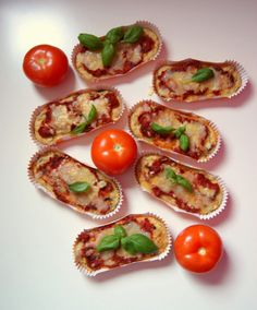 Cheesy pizza muffins with zucchini, black olives and dried tomatoes topped with aromatic marinara sauce
