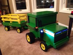 John Deere Tractor toy box with wheels, working lights and sounds. #maderemade #stepstool