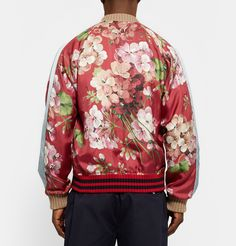 Nodding to <a href='http://www.mrporter.com/mens/Designers/Gucci'>Gucci</a>'s current penchant for bloom prints, the geranium pattern on this bomber jacket is reminiscent of 19th century botany illustrations. It's been impeccably crafted in Italy from lustrous silk-twill and reverses to offer a light-blue satin side when a more low-key look is required. Let the eye-catching palette take focus and style it simply with dark denim and white sneakers.