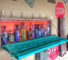 This bar brings tailgating to a whole new level. Take an old tailgate and mount it to the wall to build a drop-down bar that easily folds up when you're not using it. Car Part Furniture, Automotive Furniture, Automotive Decor, Man Cave Furniture, Furniture Design, Furniture Ideas, Modern Furniture, Man Cave Garage, Garage Bar