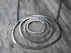 This beautiful, simple necklace is hand fabricated from sterling silver. It is 20 in length. The pendant measures 1 from top to bottom and is 2 across at widest point. An elegant piece to wear every day! The toggle is hand fabricated and organic. Metal Jewelry, Charm Jewelry, Silver Jewelry, Modern Jewelry, Simple Necklace, Ring Necklace, Nameplate Necklace, Necklace Ideas, Jewelry Party