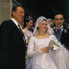 John Wayne with daughter, Melinda Ann, on her wedding day to Gregory Robert Munoz. The three are posing on the steps of Blessed Sacrament Church, 1964.  They had 5 children and divorced in 1985.