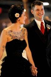Pretty tattooed bride in black