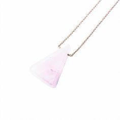 """TRIANGLE ROSE QUARTZ NECKLACE by JULIA SZENDREI. This is a custom cut Rose Quartz you'll find only here. The beautiful pink Rose Quartz has a beautiful light pop of color to add light into your day. Rose Quartz is affiliated with love, gifts of love and general heart awareness. Shine the light and enjoy this beautiful one of a kind necklace! 18.5"""" total length, 14k Gold Filled material. Shop Now www.juliaszendrei.com"""