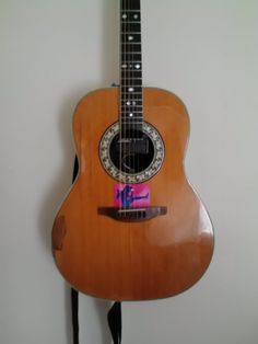 "1968 Glen Campbell artist Ovation ""top of the Line"" with slight iTunes addition"