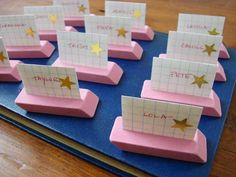 Place cards made from erasers-would be cute on desks for the first day of school. I like this better than name plates...  This is also a good idea for creating groups for students to get into when they first enter the classroom, if there will be an activity for students to do.