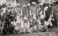 """Tribesmen from NW frontier, India, with flintlock blunderbuss, late 19th to early 20th century. Pathan (Afghan) Tribesmen - North West Frontier Province. On the reverse of this postcard, a British officer has written """"These are the hillmen we have to contend with""""! Spot the cheeky British soldier sneaking into the shot. The North-West Frontier is now the border region between Afghanistan and Pakistan."""