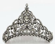 NINETEENTH CENTURY DIAMOND TIARA with a garland motif in old cut diamonds, brilliant cut diamonds with central flower featuring an old corolla and cushion cut diamond drop, with detachable tortoiseshell comb fitting and two adjustable extensions to wear the tiara. (Christies)
