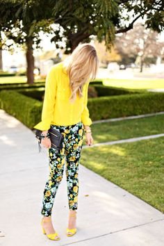 Bright and happy summer outfit with a yellow blouse and floral pants