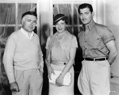 Mady Christians pays a visit to director Clarence Brown and Clark Gable on the set of Chained