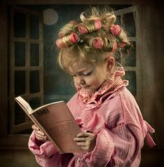 Reading in pink curlers