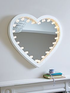Make your little one the star of the show with our Hollywood style light up mirror. Made from quality metal with a gloss white finish, our heart-shaped mirror is adorned with 24 warm white LED bulbs around the edge. Big enough to reflect your face, our Heart Light Mirror is easy to power with batteries and includes a handy on/off switch on the point of the heart. With two keyhole hooks on reverse, this mirror is perfect for displaying in their bedroom or playroom.
