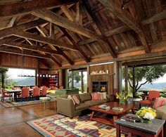 A Northern California Home Adds Rustic Flair to a Private Winery Designer Nicole Hollis separated the dining and living areas with a Reinhard von Nagel harpsichord. An antique quilt inspired the custom Tufenkian rugs. Holly Hunt sofa leather and linen. Architectural Digest, Cabin Homes, Log Homes, California Homes, Northern California, California Style, Pole Barn Homes, My Dream Home, Tiny Cottages