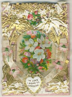 """In Love I Hope to Conquer"" Valentine with gilded lace-paper, embossed with flower motifs and the words ""TRUE LOVE"", further decorated with silk flowers and netting. Victorian Valentine Cards at the Lilly Library"
