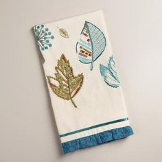 One of my favorite discoveries at WorldMarket.com: Embroidered Green and Aqua Leaves Kitchen Towel