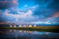 indian tepee village camp on lake near glacier park, blackfeet reservation by tony bynum