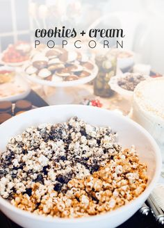 An amazing recipe for Cookies + Cream Popcorn: homemade plain popcorn slathered with white chocolate and Oreo cookies from @FeastandWest.