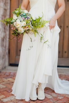Organic green + white foraged bouquet with broaches  Photography: Elyse Hall - www.elysehall.com  Read More: http://www.stylemepretty.com/southwest-weddings/2014/04/21/green-superstition-mountain-golf-and-country-club-wedding/