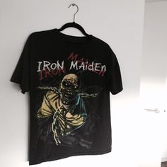 "FLASH SALE NO OFFERS Vintage Iron Maiden Tee ⚡️ awesome vintage shirt. Iron Maiden graphic on the front, ""piece of mind"" on the back. so hard to find a good vintage maiden shirt! like the one seen on JB   ⚡️sorry, no trades!  ⚡️I am a size XS for reference to modeling photos.   ⚡️fits a XS-L depending on desired fit. tag reads L but this item is pre-loved / pre-shrunk ✨ Nasty Gal Tops Tees - Short Sleeve"
