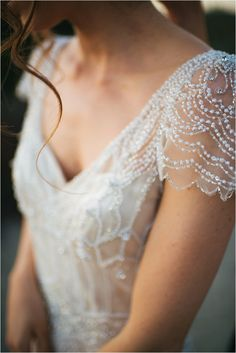 omgoodness the capped sleeves on this dress are insanely gorgeous! see more here > http://www.thesoutherncaliforniabride.com/2014/10/a-stylish-and-magical-styled-bridal.html