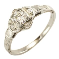 Posey: This stylized floral form looks so charming on the hand. The graceful quatrefoil of bright antique diamonds sits low to the finger and makes a twinkling frame for the center old European cut diamond. Ca.1935. Maloys.com
