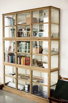 stunning glass bookcase via courtney klein, annstreetstudio Glass Bookcase, Glass Shelves, Glass Display Cabinets, Glass Cabinets, Cupboards, Wall Shelves, Vaisseliers Vintage, Home Furniture, Furniture Design