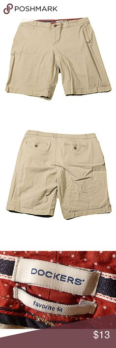 """DOCKERS Khaki Favorite Fit Shorts 14 Womens Khaki DOCKERS Favorite Fit Shorts 14 Cotton Blend.  Great pair of Dockers women's casual shorts.  Khaki.  These are the favorite fit style shorts.  Shorts have two front pockets and two back pockets.  Flat front.   Shorts zip and button in front.  Shorts do not have cuffs.  Waist:  35""""  Rise:  9 1/4"""" (measured from crotch to top of zipper) Inseam:  10"""" (measured from crotch to bottom of leg) 98% Cotton 2% Spandex / Excellent Pre-owned Conditi Item…"""