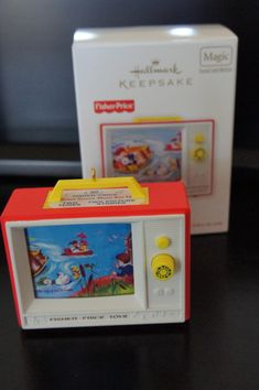 Fisher Price Hallmark 2012 Two Tune TV Ornament - Just like the full sized Giant Screen Music Box TV #114.  Adorable!