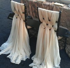 Unique chair covers. If all this fabric is not in your budget for every guest chair, Abalo Creations can do it especially for the Bride and Groom chairs. That way the beautiful couple stands out :-)