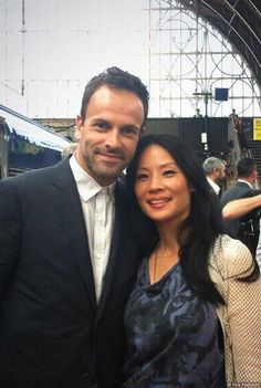 What a great shot of Holmes and Watson! Elementary Stars Jonny Lee Miller (Sherlock Holmes) and Lucy Liu (Joan Watson) on set - London, England Lucy Liu Elementary, Elementary Tv Show, Elementary My Dear Watson, Sherlock Holmes Elementary, Detective, Johnny Lee, Jonny Lee Miller, Celebs, Celebrities