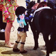 How adorable is this little rider adjusting her tack! Via @Horseandstylemag