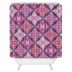 """Perfect for your guest or master bath, this printed shower curtain showcases a medallion motif and multicolor palette. Made in the USA.   Product: Shower curtainConstruction Material: 100% Woven polyesterColor: Lavender and multiFeatures:  Designed by Khristian A Howell for DENY DesignsButtonhole openings Dimensions: 69"""" H x 72"""" W Note: Shower rings not includedCleaning and Care: Machine wash cold and tumble dry"""