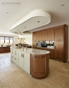 This combination of walnut kitchen furniture alongside light grey cabinets creates a beautiful balance of light and dark. Light Gray Cabinets, Open Plan Kitchen, Kitchen Ideas, Walnut Kitchen, Kitchen Colour Schemes, Bespoke Kitchens, Kitchen Living, Kitchen Furniture, Contemporary Style