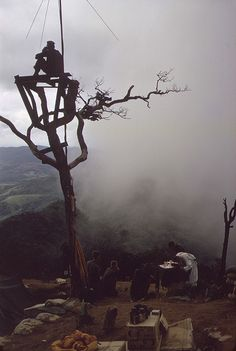Vietnam War. US Marine stands watch in an observation tower as a Marine chaplain holds mass on Hill 950. Hill 950 was one of four hills surrounding the Khe Sahn Combat base. July 31, 1967.