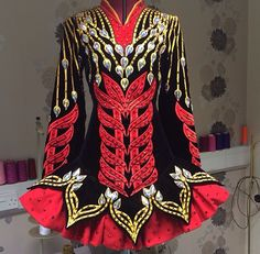 Celtic Star 2014 Irish Dance Solo Dress Costume: Interesting skirt and I wonder what fabric they are using for the red?