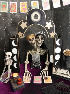 This spooky Fortune Teller's Booth is an eye-catching DIY decor project for a fun fortune-telling Halloween Party! Guests will love having their futures told by the skeleton sisters. Get all of the details for how to create it and lots of other party decor now at fernandmaple.com!