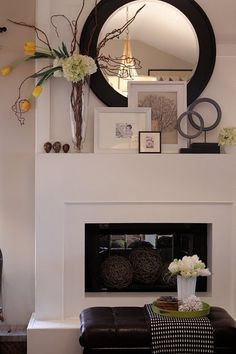 00 Love this simple fireplace and layering on the mantel. Easy to update an old fir… Love this simple fireplace and layering on the mantel. Easy to update an old fireplace with accessories. Simple Fireplace, Fireplace Design, White Fireplace, Fireplace With Mirror, Decor For Fireplace Mantle, Ideas For Fireplace Decor, Decorate Mantle, Mantelpiece Decor, Mantle Art