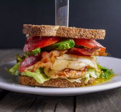 The next time you are craving a juicy fried chicken sandwich from you favorite fast food restaurant, try making this Spicy Chicken Cobb Sandwich instead. This spicy chicken sandwich recipe is easy to make and packed with flavor. Spicy Grilled Chicken, Spicy Chicken Sandwiches, Wrap Sandwiches, Gluten Free Recipes For Lunch, Lunch Recipes, Dinner Recipes, Cooking Recipes, Easy Recipes, Healthy Recipes