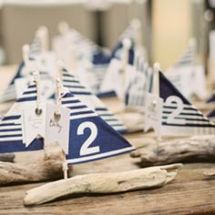 A nautical themed wedding inspiration board with blue stipes and pops of red! (image via Stephanie Hunter Photography)