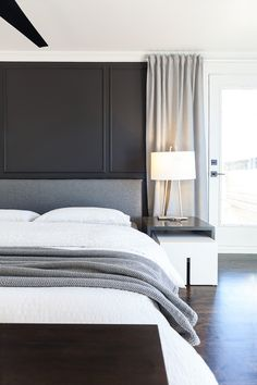 Veronica Martin | Contemporary Bedroom, Black trimmed wall, White Crown Moulding, Full Height Grey Drapery