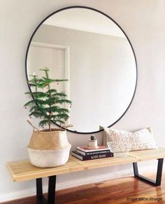 Minimal entryway decor with a large round mirror with gold frame - Decoist Decoration Hall, Decoration Entree, Hall Way Decor, House Decorations, Home Interior, Interior And Exterior, Interior Design, Bohemian Interior, Interior Styling