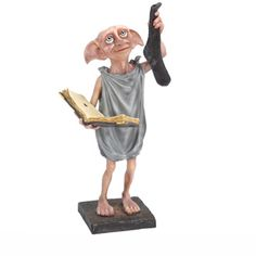 Dobby Resin Statue from Harry Potter, Noble Collection NN7872 Dobby Resin Statue from Harry Potter. It is made by Noble Collection and is approximately 24 cm (9.4 in) high    Standing approximately 9.6 inches in height this hand painted resin sculpture of everybody's favourite house elf comes in a four colour box.  #NobleCollection #Character #MiniModelPotter