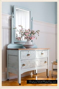 Dresser painted pale blue.  The details on the front were created with embossing plaster.