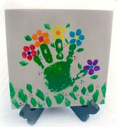 Super cute and easy arts and craft for toddler! Adorable hand-print flowers on a tile. Great as a keepsake or gift.