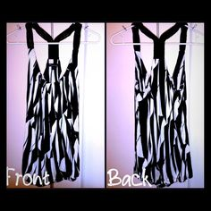 F21 Black & White Tank A gorgeous black and white abstract tank top that is pleated in the front (hard to tell in pics) with cute roped straps. The size is more like a medium!! Forever 21 Tops Tank Tops