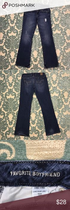 """Distressed Blue Jeans 🦋 33"""" Inseam American Eagle Outfitters Blue Jeans """"Favorite Boyfriend""""  Women's Size: 4  Material: 98% Cotton 2% Spandex  Gently used with no flaws.  Measurements lying flat: Waist 15"""", Hips 18"""", Inseam 33"""", Front Rise 7"""", Back Rise 12"""".  Please, review pictures. You will get the item shown. Smoke & pet free home. American Eagle Outfitters Jeans Boyfriend"""