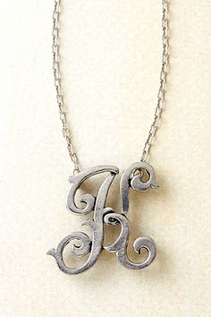 "MONOGRAM INITIAL NECKLACE - PEWTER $48.00 It's so feminine. So stylish. So you! Feel fabulous in the simplicity of your own pewter or antique gold initial.   18"" + 2"""